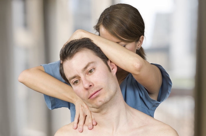Physiotherapist, chiropractor doing cervical manipulation with rotation in a clinic. Back Doctor  Man Medicine Pain Therapy Woman Cervical Chiropractor Clinic Healthcare And Medicine Injury Manipulation Massage Medical Muscles Muscular Patient person Physiotherapy Professional Stretching Therapist