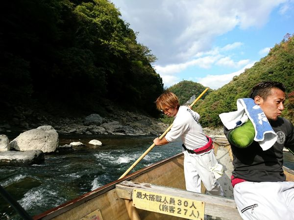 Mid Adult Two People Mid Adult Men Adults Only Mature Men Water Relaxation Vacations Outdoors Adult Mature Adult People Leisure Activity River Togetherness Day Nature Oar Men Wooden Raft Kyoto Japan