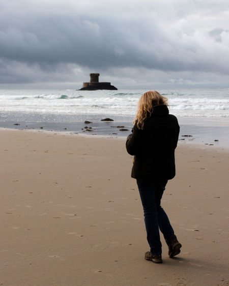 La Rocco Tower on a winter walking day along a nearly empty beach Beach Beauty In Nature Cloudy Day Full Length Horizon Over Water Jersey Channel Island UK La Rocco Tower Outdoors Quiet Rear View Sea St Ouen's Standing Tranquil Scene Vacations Walking Waves Winter Wintertime Woman Street Photography