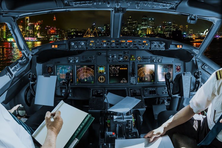 Low angle view of man working at airplane