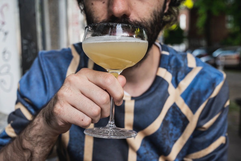 Close-up of man drinking beer glass