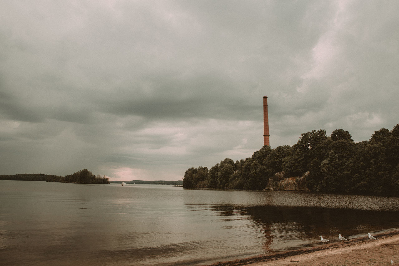 sky, water, industry, no people, smoke stack, environment, tree, cloud - sky, lake, nature, chimney, factory, outdoors, day