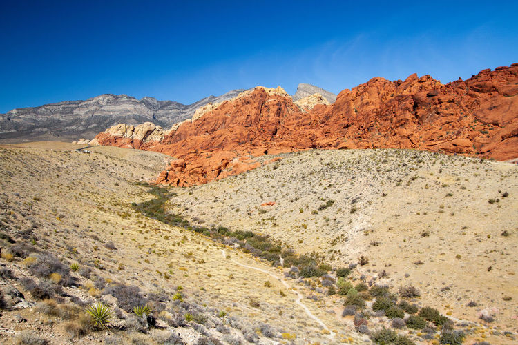 Scenic view of mountains against blue sky. red rock canyon, nevada