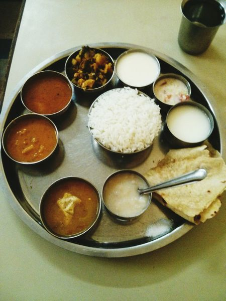 Indian Meal Thali Staple Food Rice Chapati Rasam Sambar Sabji Pickles Lassi Buttermilk Raita Food And Drink Freshness Indoors  High Angle View Bowl Indulgence Plate Ready-to-eat Tray Serving Size Dessert