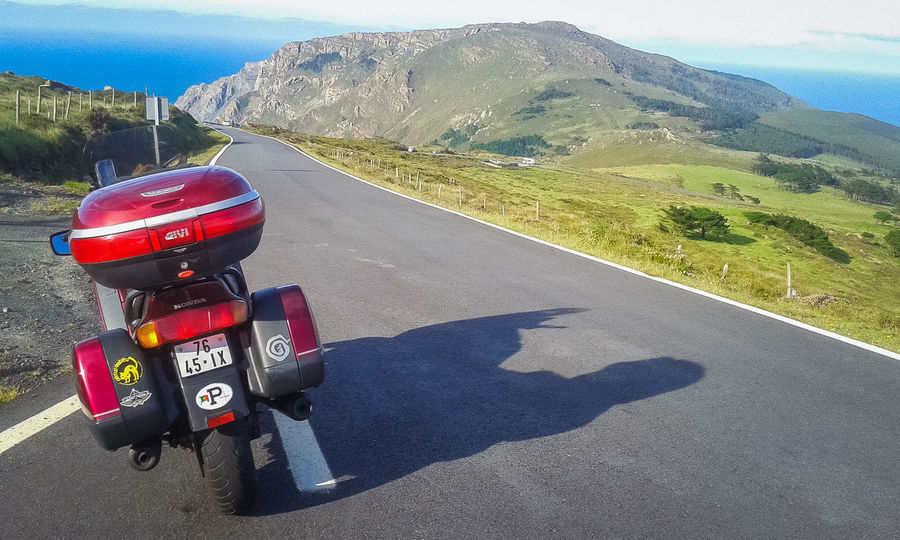 Motorcycle Travel Beauty In Nature Day Landscape Mountain Mountain Range Nature Outdoors Road Scenics Shadow Sky Sunlight Transportation