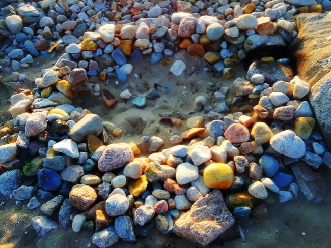 Pebble Beach Full Frame Large Group Of Objects Pebble Beach Backgrounds Nature Abundance No People Outdoors Beauty In Nature Close-up Day Sand Summer ☀ EyeEmNewHere Awesome! Likeandfollow Beauty All Around The Week On EyeEm HIKES OUTDOOR Peaceful View Rock Formations Multi Colored Firepit