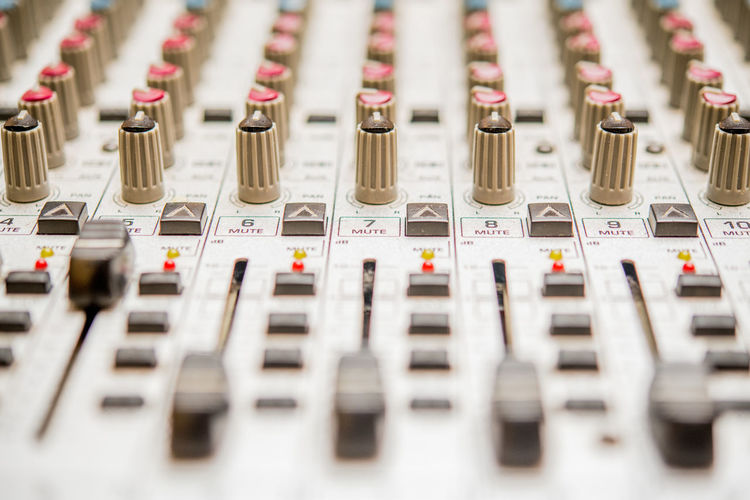 Professional music studio mixer detail close up Arts Culture And Entertainment Close-up Control Control Panel Day Full Frame In A Row Indoors  Knob Mixing Music Musical Instrument No People Recording Studio Selective Focus Sound Mixer Sound Recording Equipment Studio Studio Shot Technology