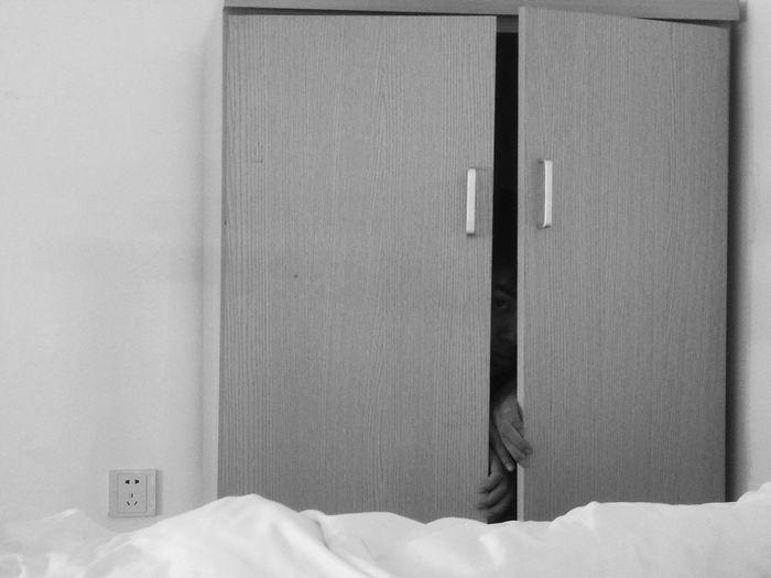 Portrait of man in cupboard