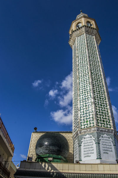 Minaret of Nabeul's Mosque Tunisia Architecture Building Exterior Built Structure City Day History Low Angle View Minaret Mosque Nabeul No People Outdoors Religious  Sky Tall - High Tower Travel Destinations Tunisie