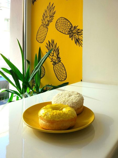 Table Indoors  Donut Donuts Donuts🍩 Pinapple Pattern No People Window Simple Color Pallet White Table Yellow Wall Yellow White Coconut Chips Coconut Frosting Glazed Donut Glazed Food Glaze Day