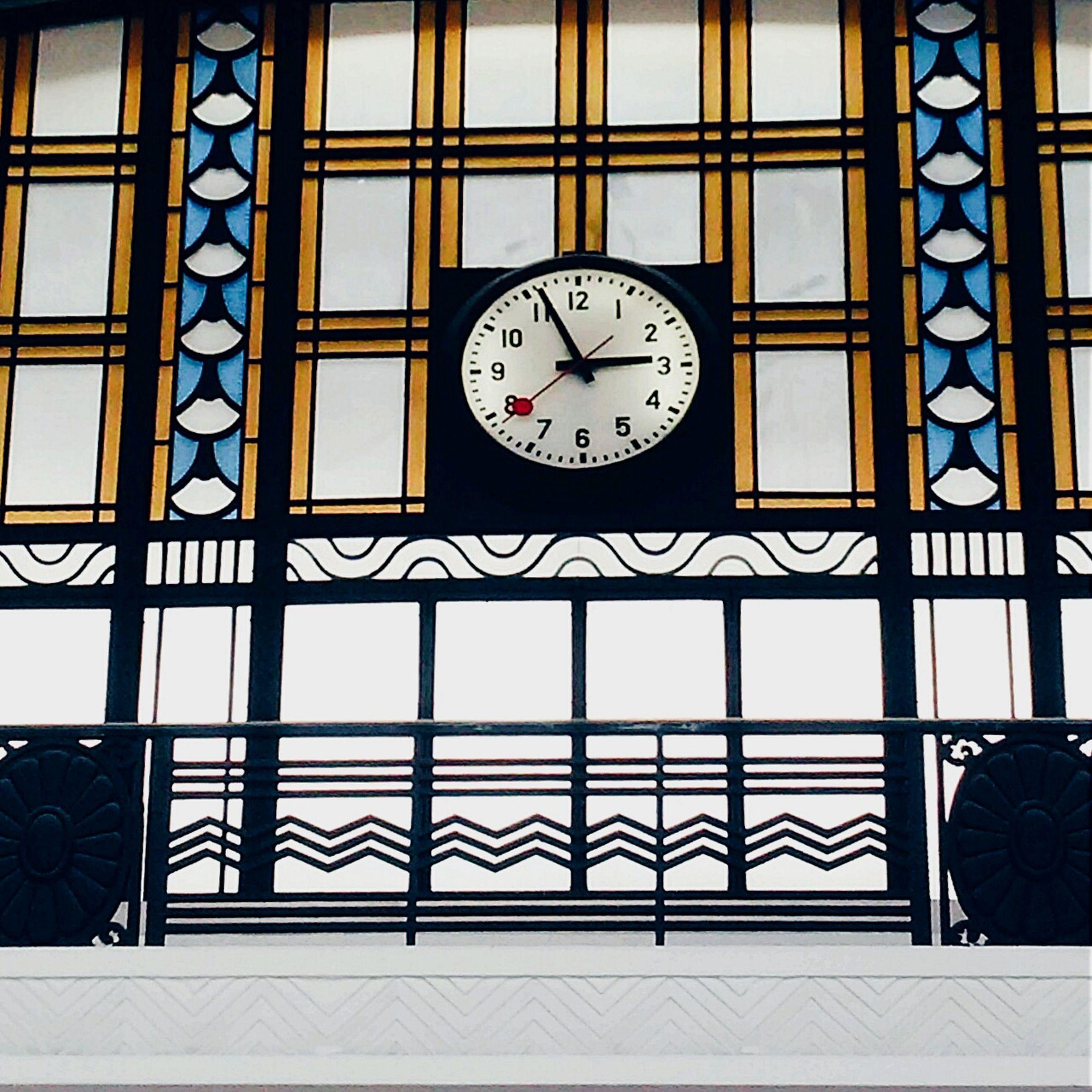 clock, time, indoors, architecture, built structure, circle, text, window, number, communication, glass - material, geometric shape, wall - building feature, roman numeral, clock face, day, old-fashioned, western script