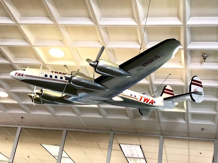 At the Burbank Airport My Day Looking Up Traveling Photography Travel Waiting For My Flight Airline History Historical The Week on EyeEm Waiting For My Flight Waiting Burbank  Airplane Historical Airplane Airport Terminal Airport Departure Area Decoration Twa Indoors  Ceiling Architecture Built Structure No People Wall - Building Feature Low Angle View Hanging Technology Transportation Air Vehicle Airport Terminal