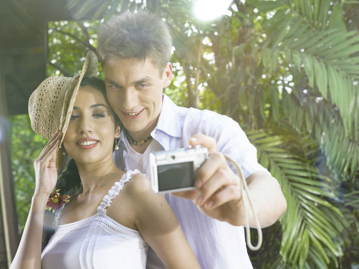 Couple Taking Selfie With Camera