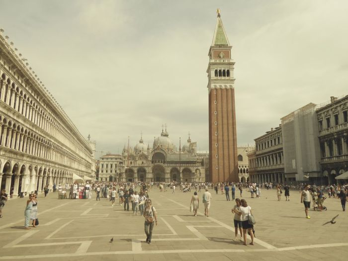 Crowd at st mark square against cloudy sky