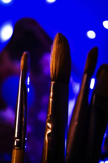 Close-Up Of Make-Up Brushes In Illuminated Room