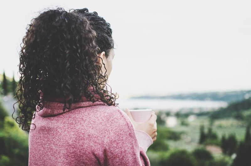 Rear View Focus On Foreground One Person Day Outdoors Curly Hair Childhood Headshot Real People Girls Close-up Sky Human Body Part One Woman Only Only Women Nature People Adult View Viewpoint Europe Italy LakeGarda Sports Tea