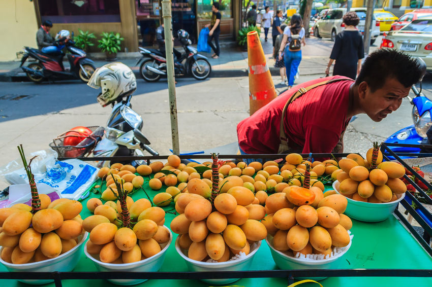 Bangkok, Thailand - March 2, 2017: Plango fruit vendor in Bangkok, Plango fruit or Marian Plum, famous tropical fruit in Thailand. Sweet Maprang or Mayongchid (Bouae bumanica Griff) Bouae Bumanica Bouae Bumanica Griff MaYongChit Mayongchid Fruit Plango Plango Fruit Plango Thai Tropical Fruits Abundance Business Day Food Food And Drink For Sale Freshness Fruit Healthy Eating Incidental People Large Group Of Objects Maprang Marian Plum Market Market Stall One Person Orange Orange Color Outdoors Real People Retail  Retail Display Sale Selling Small Business Street Market Wellbeing