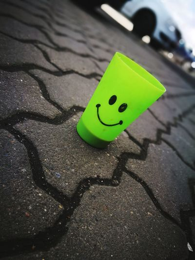 Green Color No People Day Outdoors Plastic Plastic Cup Cofee Hour Asphalte Happiness Is Everywhere Social Issues Close-up Crisis