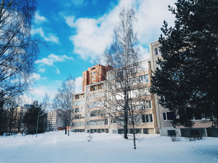Low angle view of buildings against sky during winter