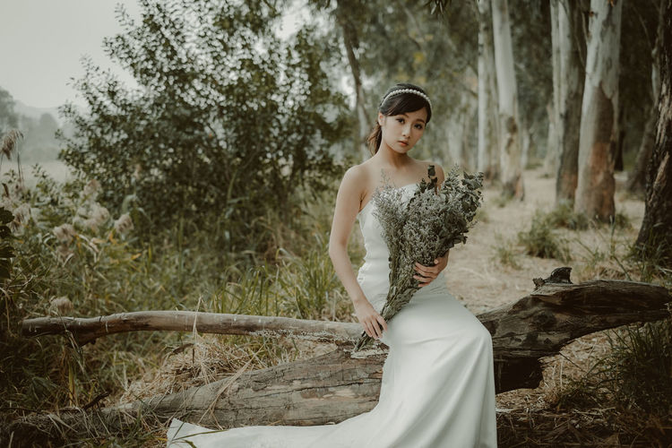 Adult Adults Only Beauty Bride Charming Day One Person One Woman Only One Young Woman Only Only Women Outdoors People Period Costume Tree Wedding Dress Women Young Adult