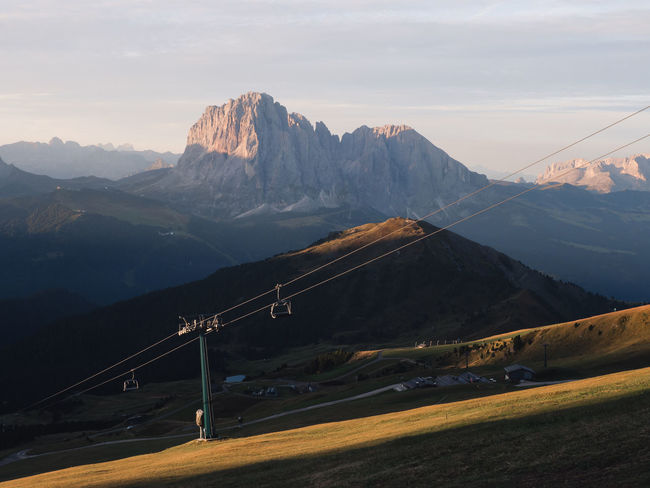 Soft morning light spills into the Valley of Val Gardena, Italy. Week On Eyeem Mountain Mountain Range Environment Sky Scenics - Nature Beauty In Nature Landscape Non-urban Scene Nature No People Tranquil Scene Tranquility Cloud - Sky Road Idyllic Snow Outdoors Snowcapped Mountain Mountain Peak Dolomites Dolomites, Italy Val Gardena Sunrise Travel Destinations Autumn Mood A New Perspective On Life