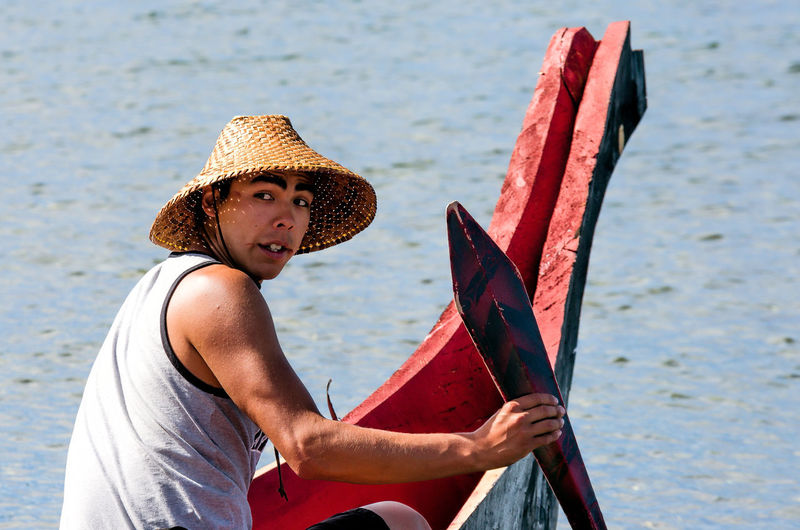 First Nations Paddler Carefree Day Focus On Foreground Holding Lake Water