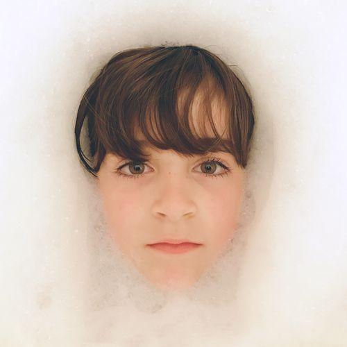 Portrait of boy in bathroom
