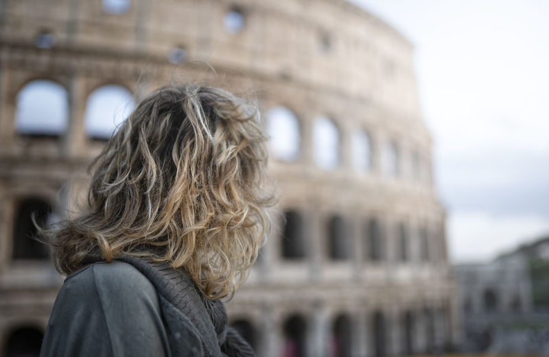 Woman looking at coliseum