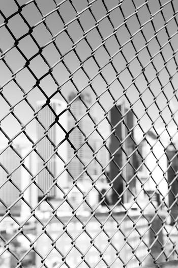 Full frame shot of chainlink fence in city