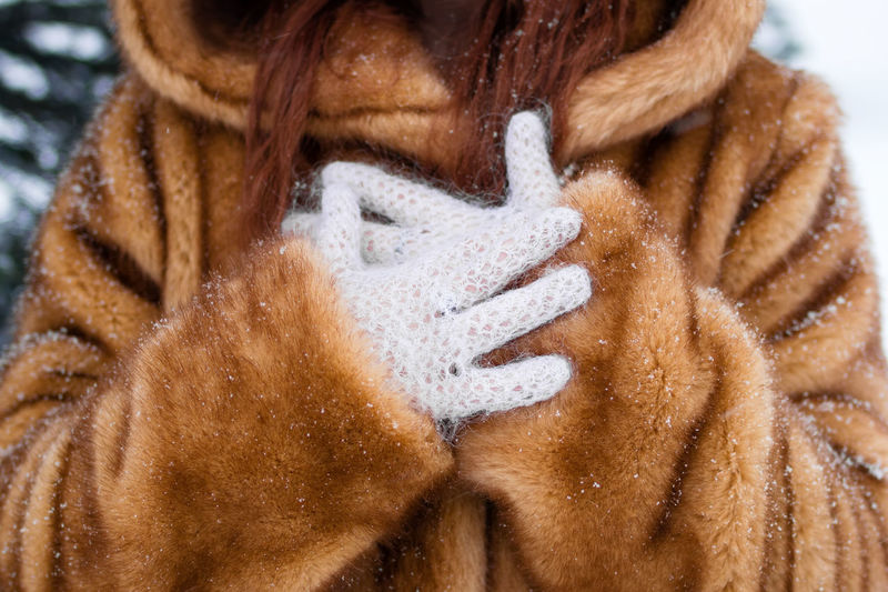 Close-up of human hand on snow