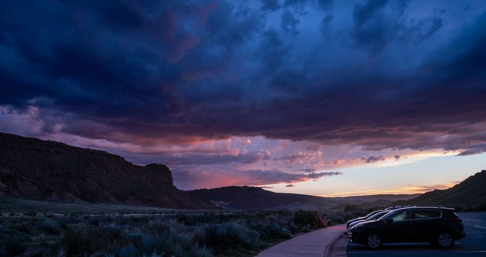 Stormy pushes Arches National Park, Utah USA Moab  Transportation Cloud - Sky Sky Mode Of Transportation Motor Vehicle Scenics - Nature Car Mountain Environment Dramatic Sky Dusk Landscape Beauty In Nature