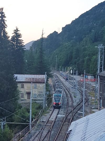 Railroad Track Train - Vehicle Rail Transportation Transportation Public Transportation Mode Of Transport High Angle View Tree No People Travel Railroad Station Steam Train Outdoors Sunset Locomotive Subway Train Day Commuter Train Sky Limone Piemonte Travel Destinations
