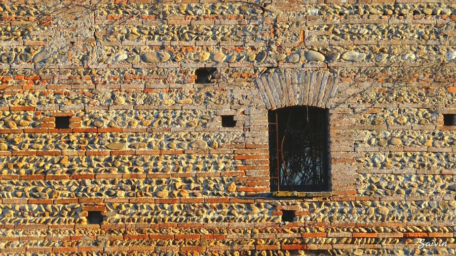 Window Shape And Form Textures And Surfaces Texture Pebbles Pebble Wall Brick Wall Architecture Wall Ladyphotographerofthemonth Windows Shades Of Orange Showcase: January Here Belongs To Me