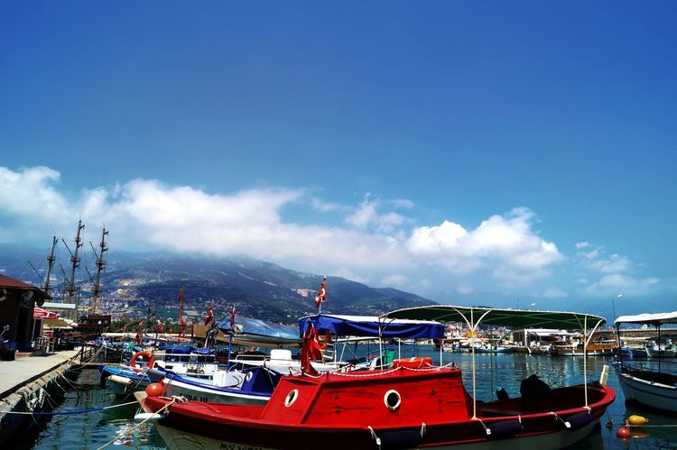 Harbour View Harbour Insights Focus On Foreground,shallow Focus Red Boat Fishermen Boat Colorful View Mountains And Clouds In The Background Blue Sky White Clouds Blue Water Blue Sky Beliebte Fotos Hello World Colour Of Life Alanya Turkey Showcase August