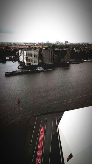 High Angle View Netherlands Amsterdam Skyline Cloudy A'dam Toren Travel Destinations Cityscape Lookout Tower Water Amsterdam Urban Skyline Cloud - Sky Traveltheworld A'toren The Architect - 2016 EyeEm Awards River City Built Structure Transportation No People Sky