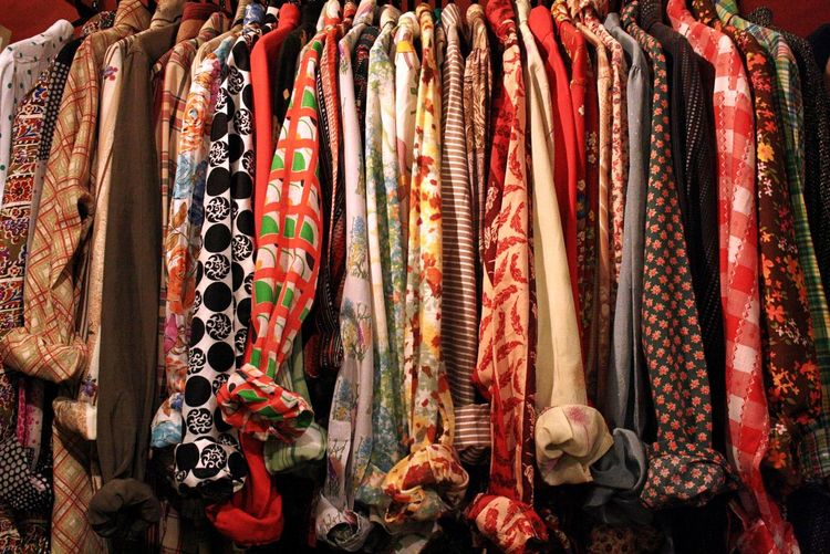 Close-Up Of Clothes Hanging In Row For Sale