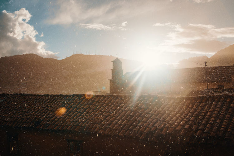Sitting in my favorite café watching the rainy sunset. Andes Backpacking City Cityscape Exploring Inca Latin America Rain Architecture Brightly Lit Built Structure Cityscape Colonial Day Discover  Lens Flare No People Outdoors South America Sunbeam Sunlight Sunny Sunset Travel Destinations Urban The Traveler - 2018 EyeEm Awards