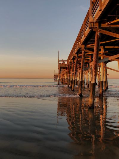 Sunrise_sunsets_aroundworld Sunrise Newport Beach Architecture Architecture_collection Ocean Wood Structure Pier Pacific Sunrise Tranquility Pier Sky Scenics Shore Outdoors Beauty In Nature Built Structure Architecture Waterfront Wood - Material No People