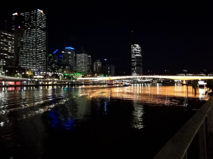 City City Life Reflection Architecture Building Exterior Built Structure City Cityscape Illuminated Modern Night Nightlife No People Outdoors Reflection Sky Skyscraper Travel Destinations Urban Skyline Water Waterfront