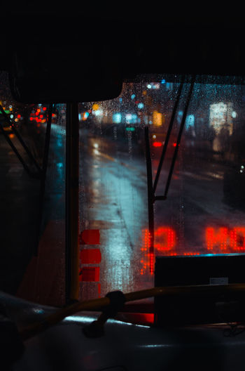 Bus Reflections Architecture Atmospheric Mood Building Exterior Built Structure Car City Glass - Material Illuminated Land Vehicle Mode Of Transportation Motion Motor Vehicle Night No People Rain Rainy Season Street Streetphotography Transparent Transportation Vehicle Interior Wet Window