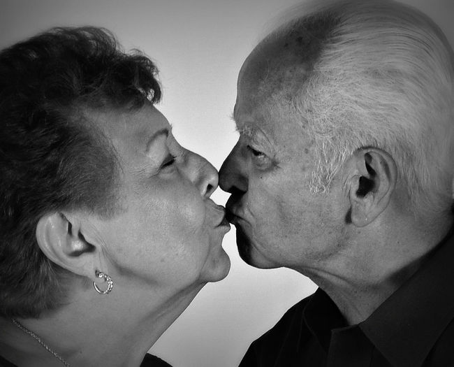 Close-Up Of Senior Man And Woman Kissing