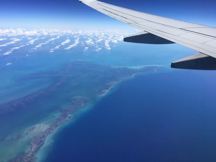 Aerial View Air Vehicle Aircraft Wing Airplane Airplane Wing Beauty In Nature Blue Cuba Day Flying Journey Landscape Mode Of Transport Nature No People Outdoors Scenics Sky Tranquil Scene Tranquility Transportation Travel Vehicle Part View Into Land Water