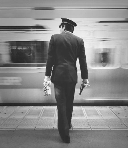 Security Guard Looking At Subway Train