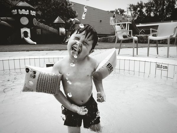 Water Fun Wet Shirtless Boys Childhood People Child Day Children Only One Boy Only One Person Summer Enjoyment Playing Outdoors Happiness Real People Vacations Standing Mix Yourself A Good Time