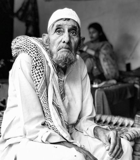 Portrait of senior man sitting
