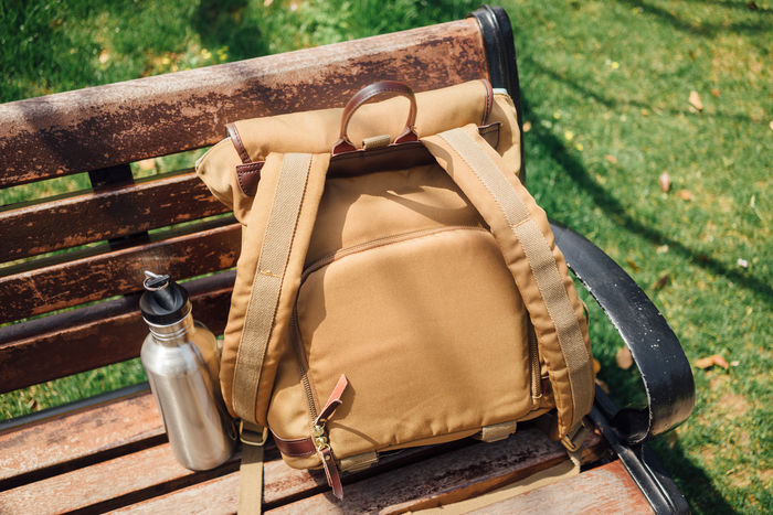 Bag Bench Bottle Brown Close-up Container Day Focus On Foreground Food And Drink Grass High Angle View Nature No People Outdoors Park Bench Plant Seat Sunlight Wood - Material