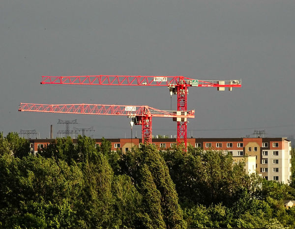 Architecture Building Exterior Built Structure Construction Site Cranes End Of Working Day Evening Sunshine Growth Outdoors Sky Weekend