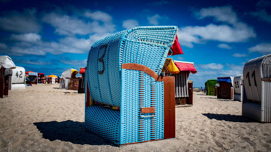 Hooded Beach Chair Against Blue Sky During Sunny Day
