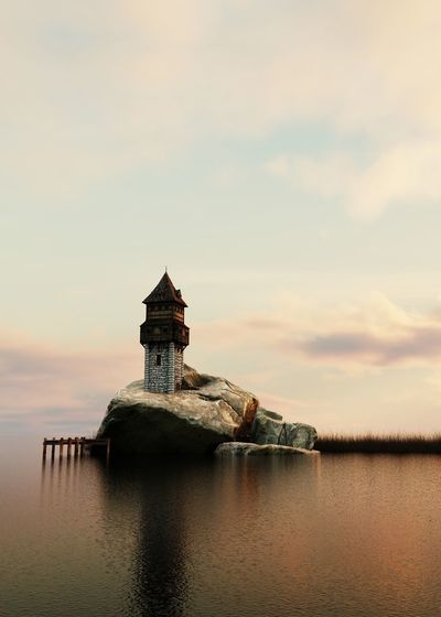 Tower on rock in sea against cloudy sky during sunset