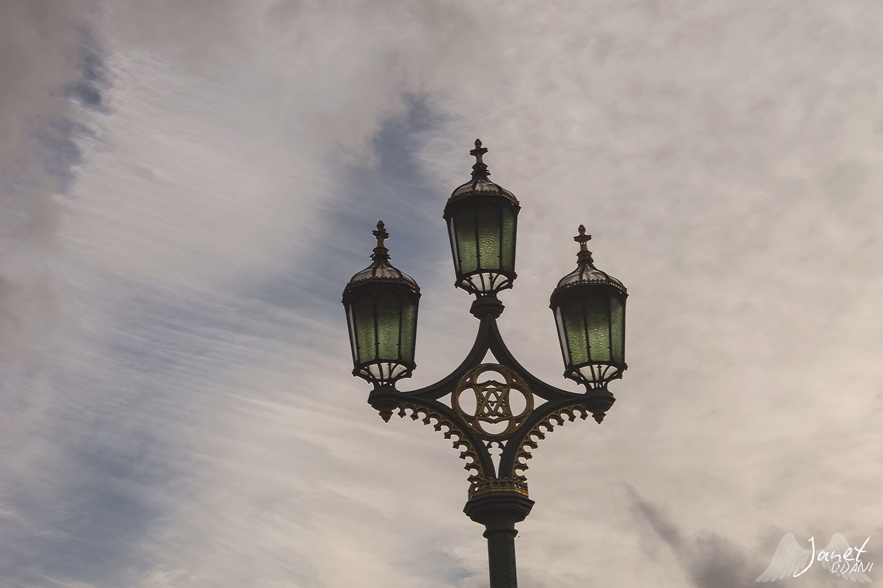 lighting equipment, sky, low angle view, street light, cloud - sky, street, nature, no people, day, architecture, outdoors, antique, retro styled, built structure, electricity, gas light, metal, electric lamp, electric light, ornate, light